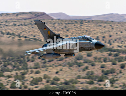 A German Air Force Tornado fighter aircraft approaches ground training targets during the live fly Bold Quest at - Stock Photo
