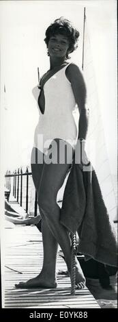 Aug. 08, 1970 - Adams is currently filming the movie ''Sapho'' in Cannes. She is pictured here taking a break from - Stock Photo
