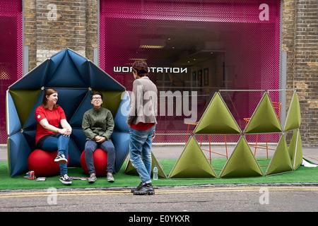 people enjoying Street Design furniture at Clerkenwell Design Week 2014, London - Stock Photo