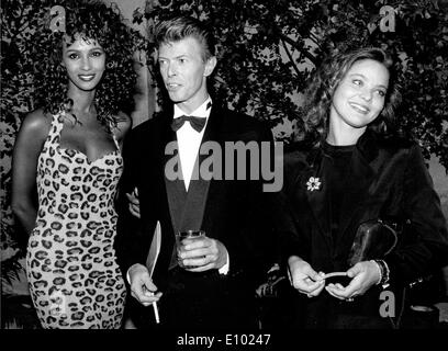Singer David Bowie with Iman and Ornella Mutti - Stock Photo