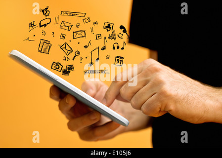 Male Hands with tablet computer and various doodle icons. Using modern technology gadgets. - Stock Photo