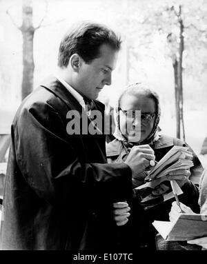 Singer Pat Boone signs autograph for woman - Stock Photo