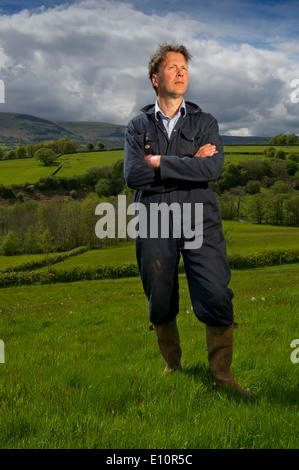 Farmer John Lewis-Stempel has written a book about meadows and is seen in a Herefordshire field surrounded by buttercups.a - Stock Photo