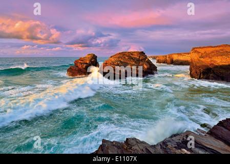Spain, Galicia: Twilight view of beach Praia As Catedrais - Stock Photo