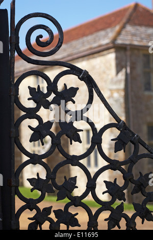 looking through wrought iron gate at Carisbrooke Castle, Carisbrooke, Newport, Isle of Wight, Hampshire UK in May - Stock Photo