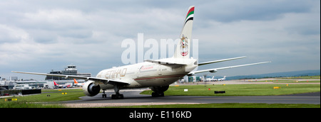 Etihad Airways Boeing 777-3FXJER Airliner A6-ETP Taxiing on Arrival at Manchester  Airport England United Kingdom - Stock Photo