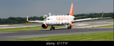 Easyjet Airline Airbus A320-214 Airliner G-EZWH Taxxiing on Arrival at Manchester International Airport England - Stock Photo
