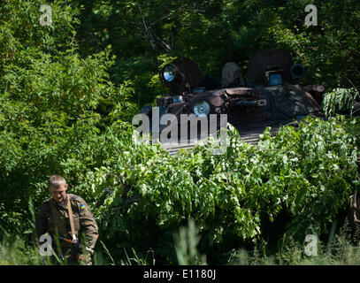 Donetsk, Ukraine. 21st May, 2014. A soldier stands near an armed vehicle at a check point near Donetsk, Ukraine, - Stock Photo