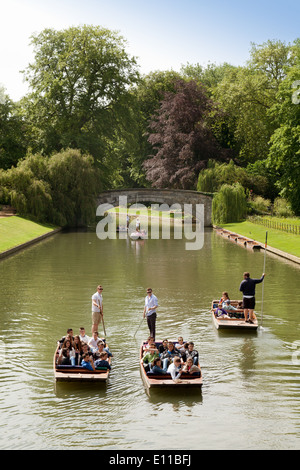 Punting on the River Cam in Cambridge between Clare and Kings bridges on the backs, Cambridge UK - Stock Photo