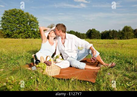Aug. 28, 2009 - Aug. 28, 2009 - Picnic - Romantic couple in spring nature on sunny day C - Stock Photo
