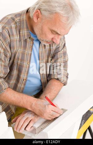 Nov. 24, 2010 - Nov. 24, 2010 - Home improvement - handyman measure porous brick in workshop © CTK/ZUMAPR - Stock Photo