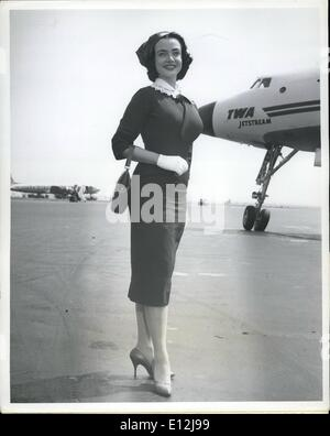 Feb. 24, 2012 - Idlewild Airport, N.Y., April 18-- Voluptuous Singer- Actress Kitty Dolan, 20, stands out Beautiful - Stock Photo