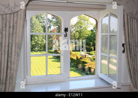 Gardens from the Butler's Room, The Manor, 16thC hotel, Weston-on-the-Green, Oxfordshire, England, Great Britain, - Stock Photo