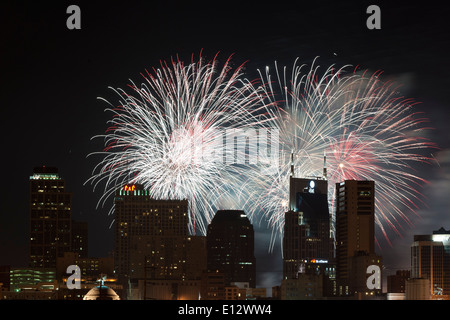 Fourth of July celebration with  fireworks over the Nashville Skyline - Stock Photo