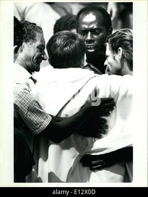 Feb. 25, 2012 - A priest is embraced by Cuban refugees after he helped deliver a religious ceremony to the newly - Stock Photo