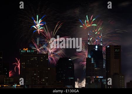 Fourth of July celebration with  fireworks over the Nashville Skyline - Stock Photo