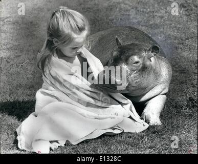 Feb. 26, 2012 - Preparing for the tourist season - What with wallowing In the mud for most of the day, a young hippo - Stock Photo