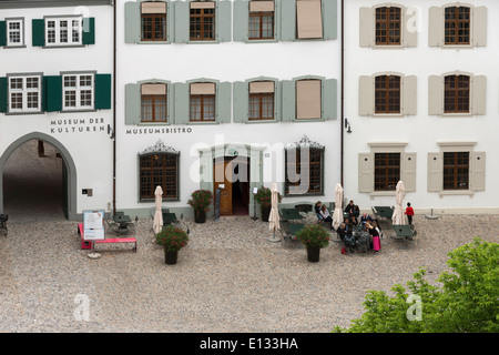 Munster Platz, tourists enjoying a drink outside the Museums bistro, Old Basel, Switzerland - Stock Photo