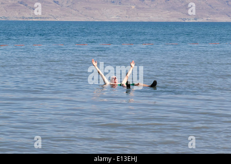 Man floating in the Dead Sea, Israel - Stock Photo