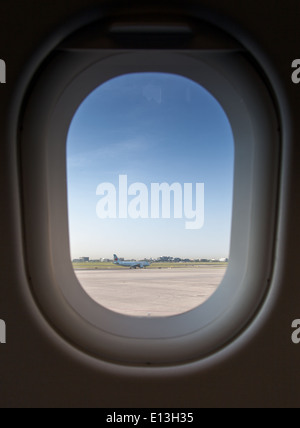 View of an airplane from another airplane window - Stock Photo