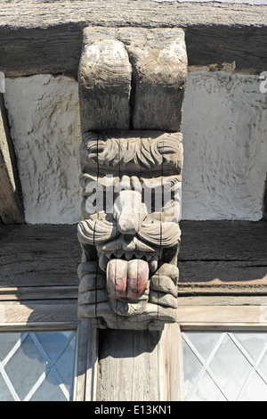 Grotesque wooden gargoyle timber support on the Old Courthouse Hastings England GB UK - Stock Photo