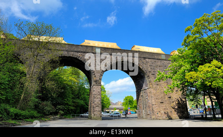 A freight train crossing the old Victorian viaduct Buxton Derbyshire England UK