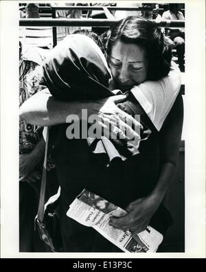 Mar. 22, 2012 - A Cuban refugee woman gives a tearful hug to a nun after the sisters had helped deliver the first - Stock Photo