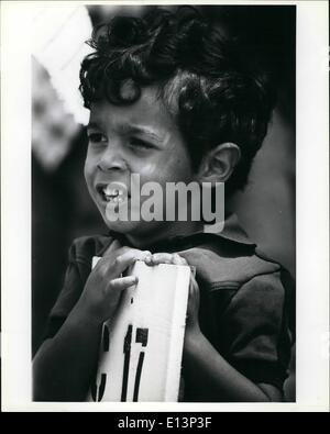 Mar. 22, 2012 - A young Cuban refugee leans against the sign that shows the number of the tent that he temporarily - Stock Photo
