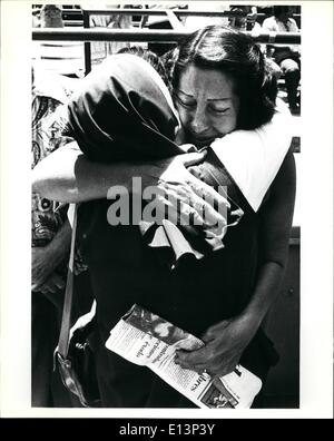 Mar. 22, 2012 - A Cuban refugee woman gives a tearful hug to a nun after the sister had helped deliver the first - Stock Photo