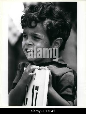 Mar. 22, 2012 - A young Cuban refugee leans against the sign that shows the number of the tent that he temporally - Stock Photo