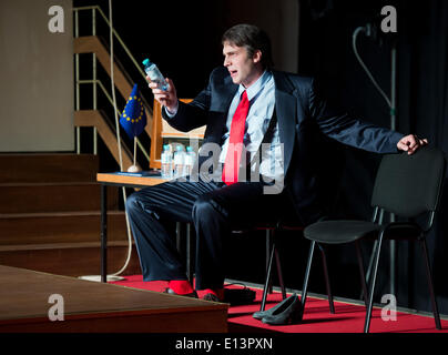 Actor Michael Waechter as Sigmar performs a scene from the play 'Mom' by Juli Zeh and Charlotte Roos in the Hall - Stock Photo