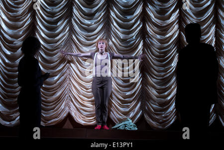 Actress Nadja Robine as Angela performs a scene from the play 'Mom' by Juli Zeh and Charlotte Roos in the Hall King - Stock Photo