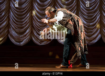 Actors Stephan Grossmann as Hellmann and Nadja Robine as Angela perform a scene from the play 'Mom' by Juli Zeh - Stock Photo