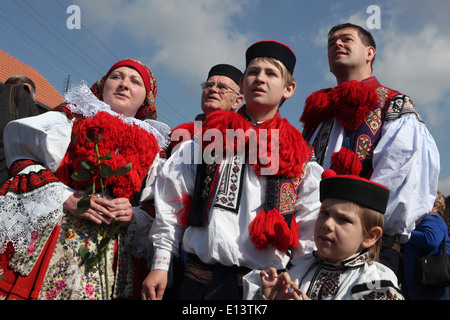 The Ride of the Kings. Traditional folklore festival in Vlcnov, Czech Republic. The boy king with his family. - Stock Photo