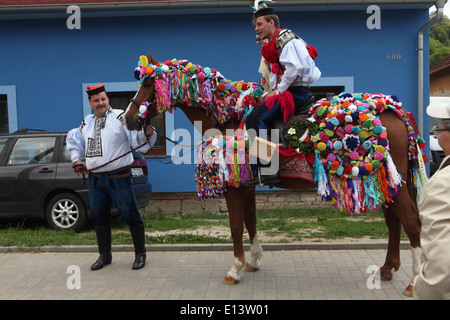 The Ride of the Kings. Traditional folklore festival in Vlcnov, Czech Republic. Young man perform the Recruit. - Stock Photo
