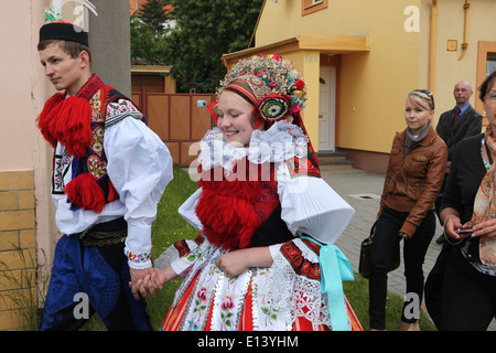 The Ride of the Kings. Traditional folklore festival in Vlcnov, Czech Republic. Couple dressed in traditional folk - Stock Photo