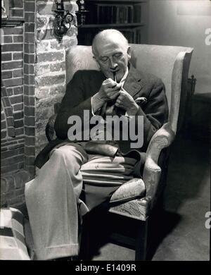 Mar. 31, 2012 - Mr. Alan Alexander Mlne A.A. Milne enjoys a quite pipe in the comfortable living room of his home - Stock Photo