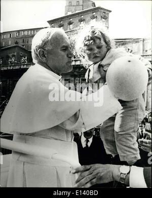 Mar. 31, 2012 - Porp John Paul II shot in St Peter's Square: Pope John Paul II, seen as he lift's a little girl - Stock Photo
