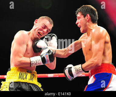 Leeds, UK. 21st May, 2014. Gavin McDonnell gets a shot in on Josh Wale during their fight at The First Direct Arena. - Stock Photo