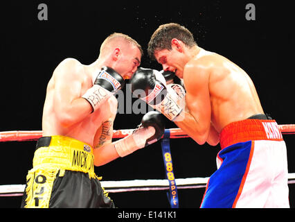 Leeds, UK. 21st May, 2014. Josh Wale counters with a strong left to the body of Gavin McDonnell during their fight - Stock Photo