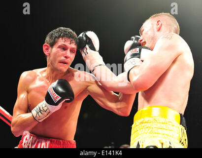 Leeds, UK. 21st May, 2014. Gavin McDonnell gets a left through the defense of Josh Wale during their fight at The - Stock Photo