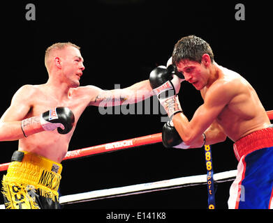 Leeds, UK. 21st May, 2014. Josh Wale gets in a jab on opponent Gavin McDonnell during their fight at The First Direct - Stock Photo