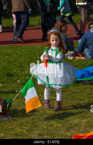 little girl wearing national colours of Ireland in celebration of st patricks day - Stock Photo
