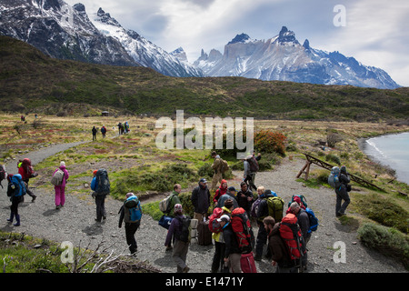 Trekkers at Torres del Paine National Park. On the background the Paine massif. Patagonia. Chile - Stock Photo
