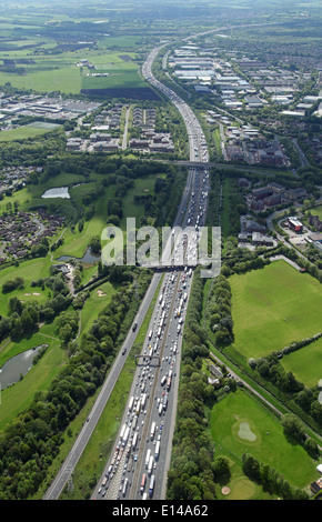 aerial view of the M6 motorway chocker block full of traffic in jam at Warrington in Cheshire - Stock Photo