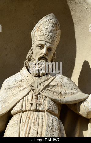 Catholic Bishop Wearing Mitre or Miter Sculpture Chapelle des Penitents Blancs (1680) or Chapel of White Penitents - Stock Photo