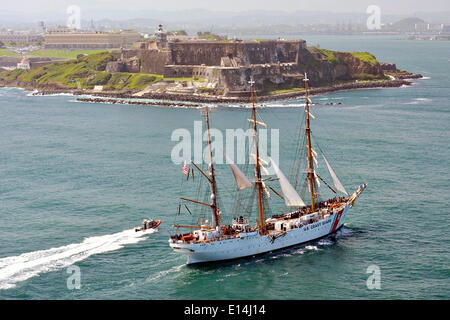 US Coast Guard tall sailing ship Barque Eagle sails past Fort Castillo de San Cristóbal May 21, 2014 in San Juan, - Stock Photo