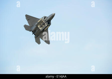 A US Air Force F-22 Raptor stealth fighter aircraft during an aerial demonstration May 21, 2014 at Langley Air Force - Stock Photo