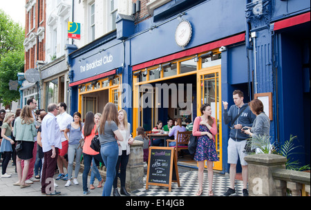 Queues Outside The Breakfast Club Cafe on Battersea Rise in London UK - Stock Photo