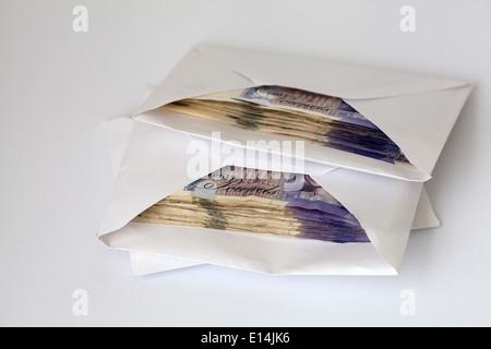 Cash in Envelopes - UK - Stock Photo